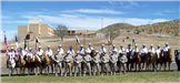 Image of Honor Guard on horse and standing in uniform