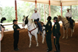 Officer with academy officers in horse pen
