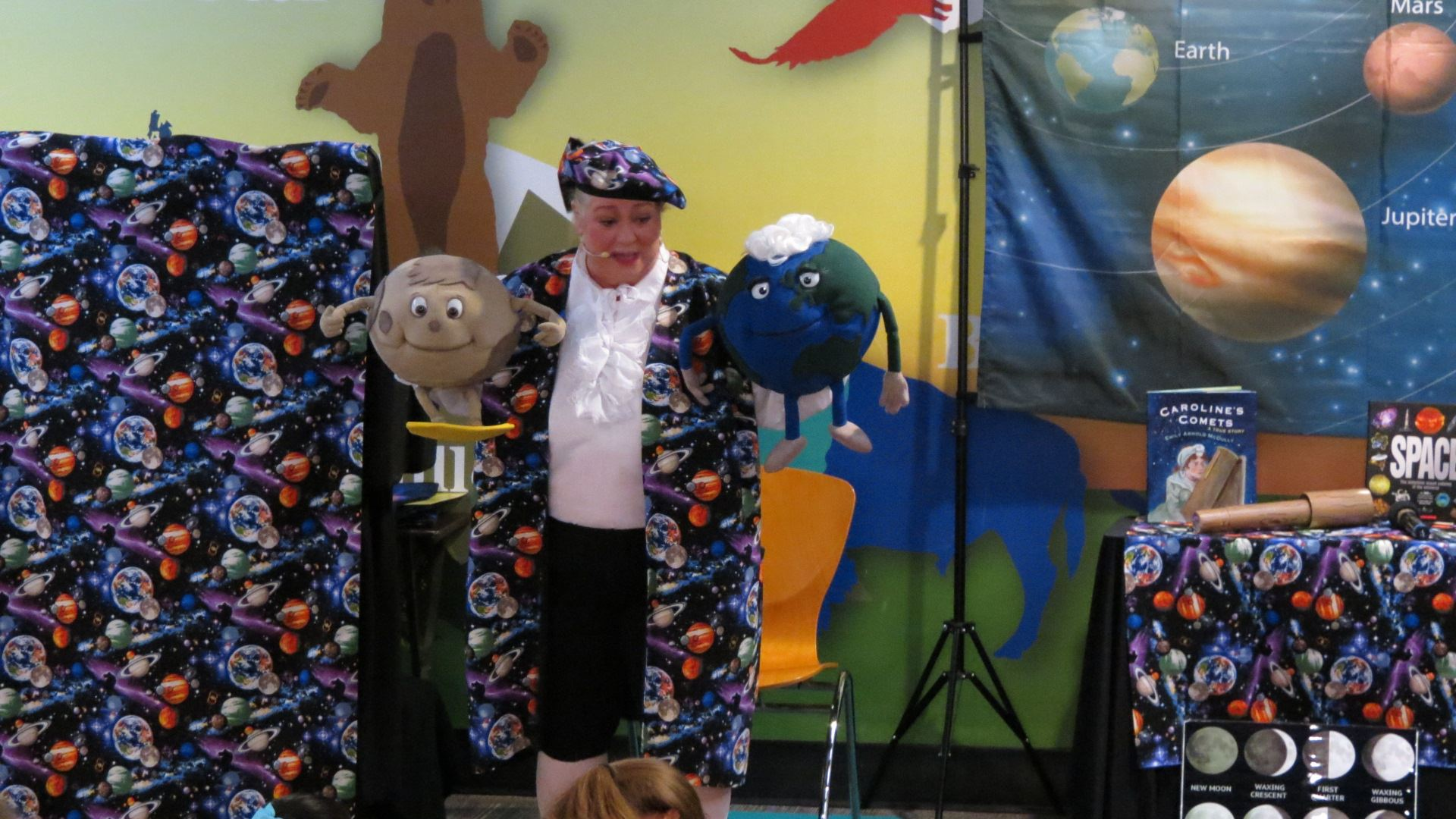 Margret Clowder with Earth and Moon puppets.