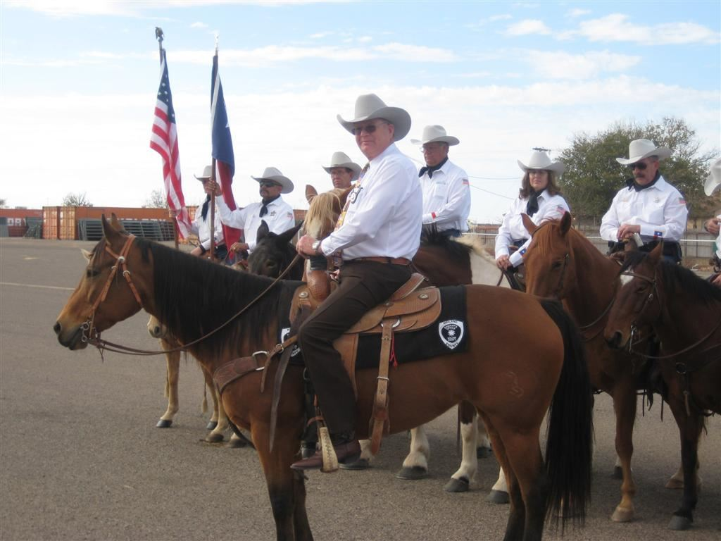 Officers on horseback preparing for mounted patrol