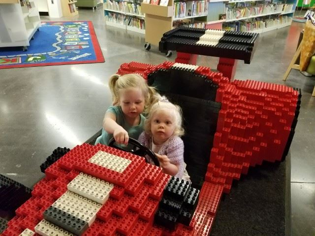 Two little girls in lego car