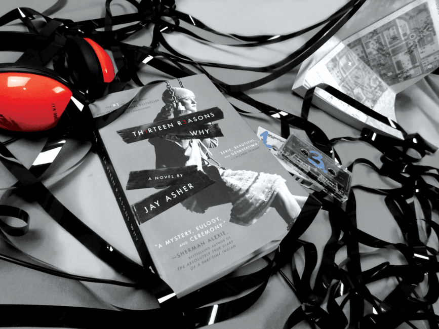 Image of a book on a table with headphones